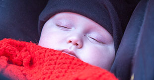 Baby asleep in a pram