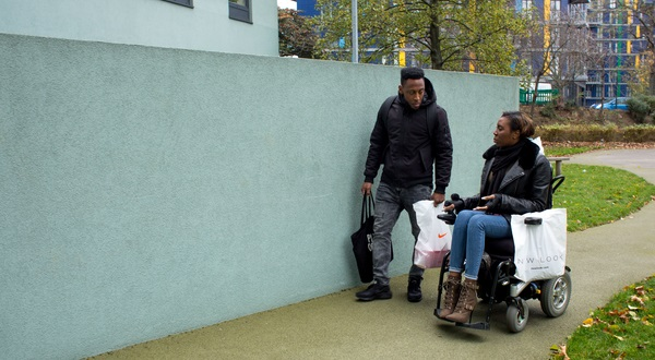 lady in wheelchair with carer outside