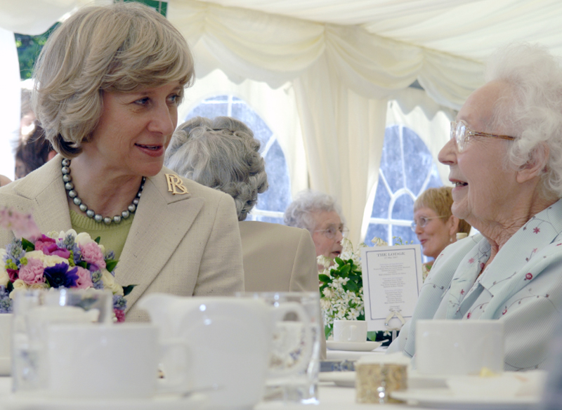 People talking over tea at a fundraising event