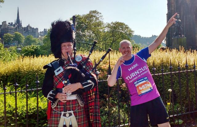 Turn2us runner with piper in Edinburgh