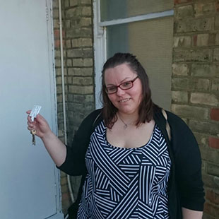 Elissavet with the keys to her new home