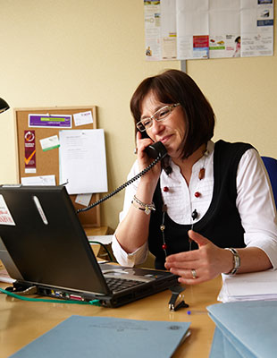 Charity worker at her desk