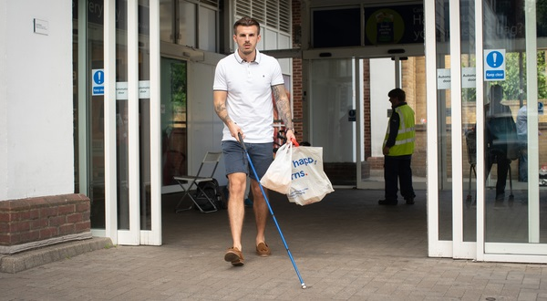 Blind man leaving supermarket