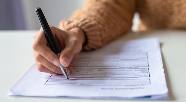 A woman filling in a form