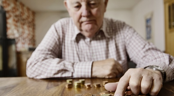 Pensioner counting pennies