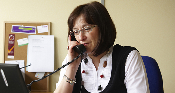 Charity worker on the phone