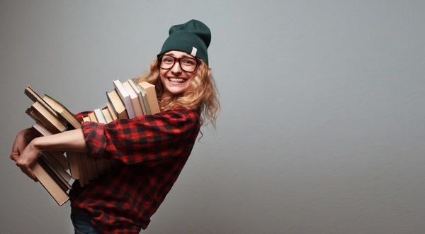 A student holding books