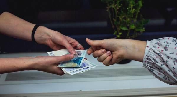 Hands exchanging money