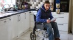 Man sitting in a wheelchair in a kitchen