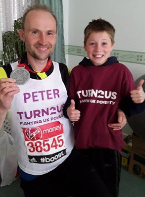 Peter and son with marathon medal